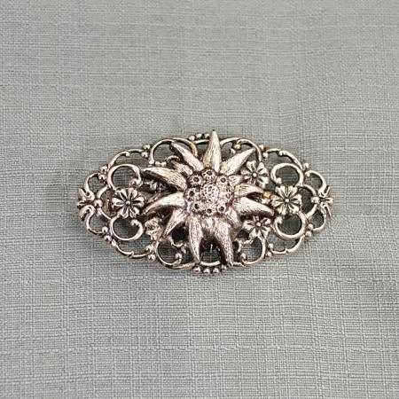 filigree designed brooch